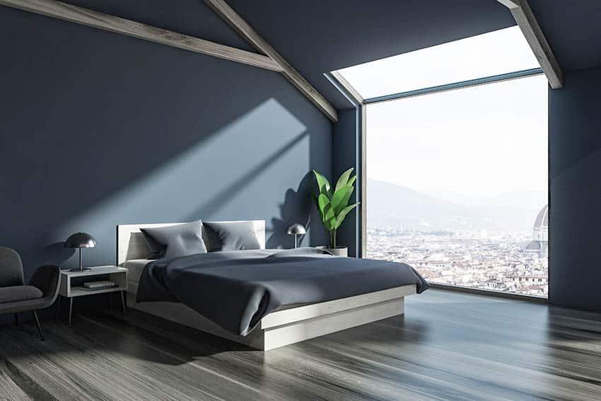 Penthouse bedroom with dark gray walls gray flooring