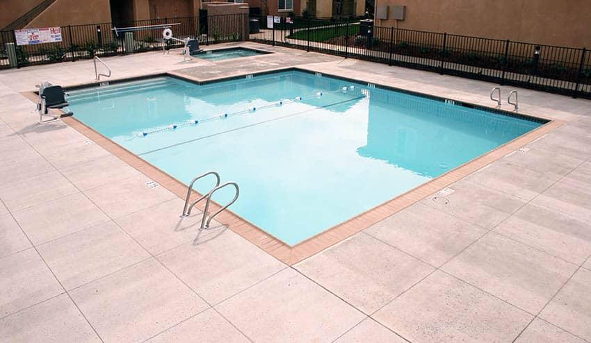 Public swimming pool with concrete salt finish deck
