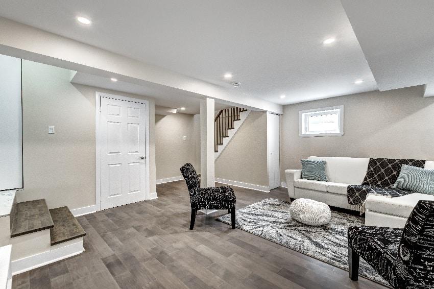 renovated modern stylish basement living room with wood tile flooring