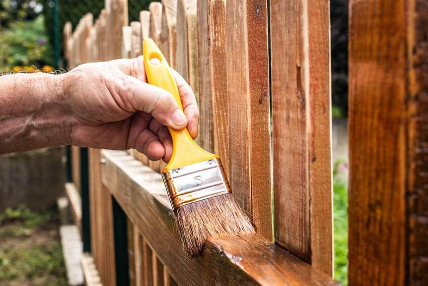 Restaining wood fence