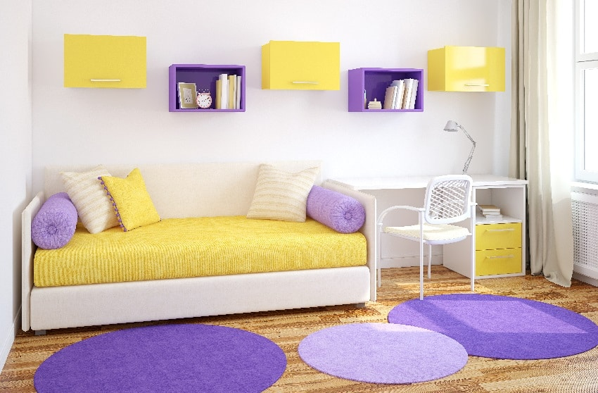 room with yellow and beige sofa purple mats cabinets white armchair and table