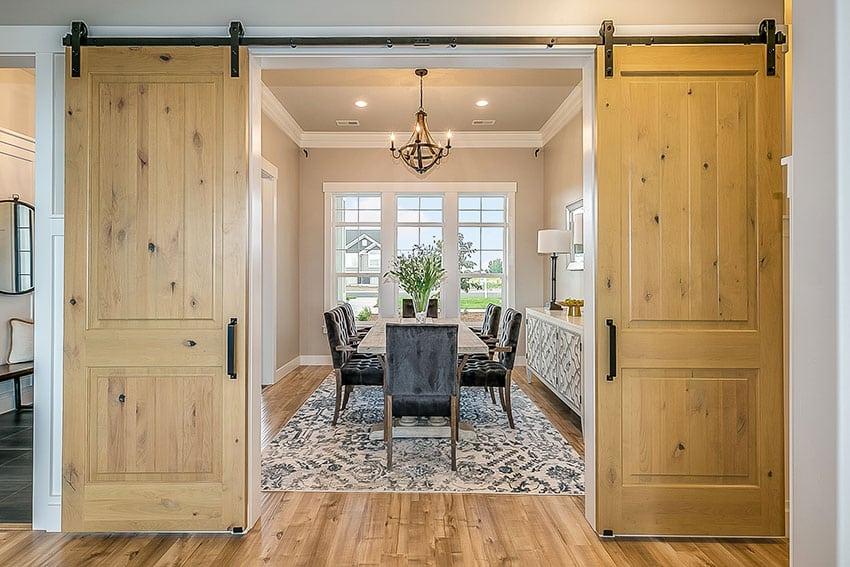 Barn door with wooden floor dining set