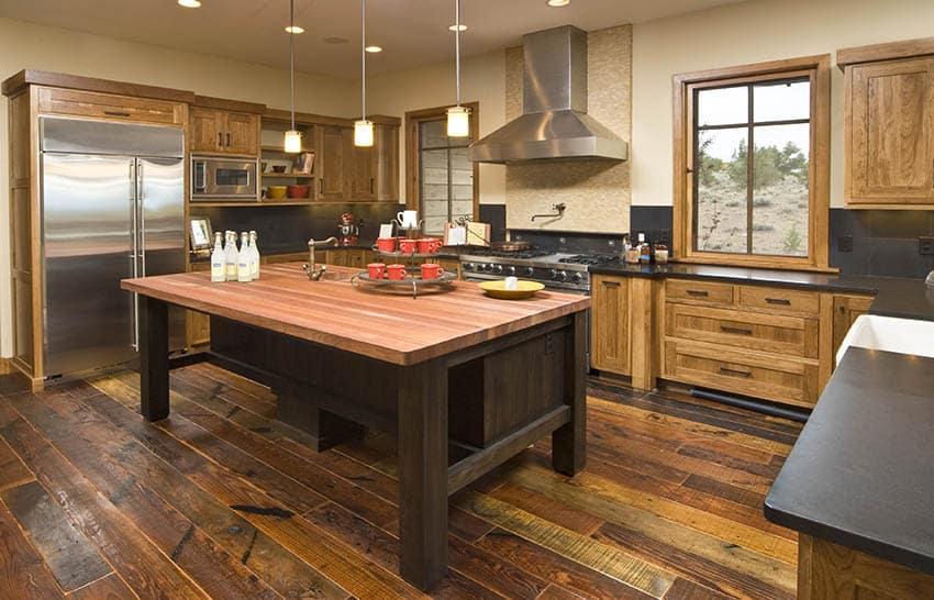 Rustic kitchen with edge grain butcher block countertop island solid wood cabinets hardwood flooring