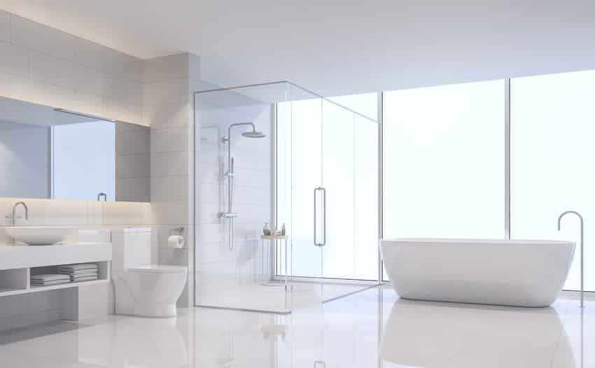 Semi-framed bathroom with curbless shower next to freestanding tub