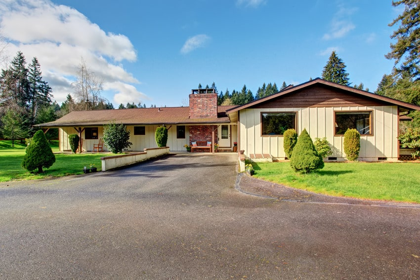 Small authentic home with long asphalt driveway