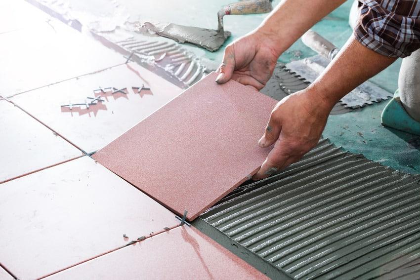 Installing soundproof floor tiles