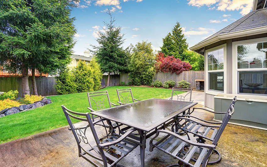 Stained concrete patio with outdoor dining table
