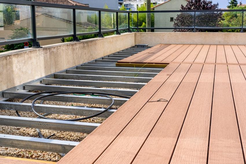 Steel bars underneath wood planks deck construction
