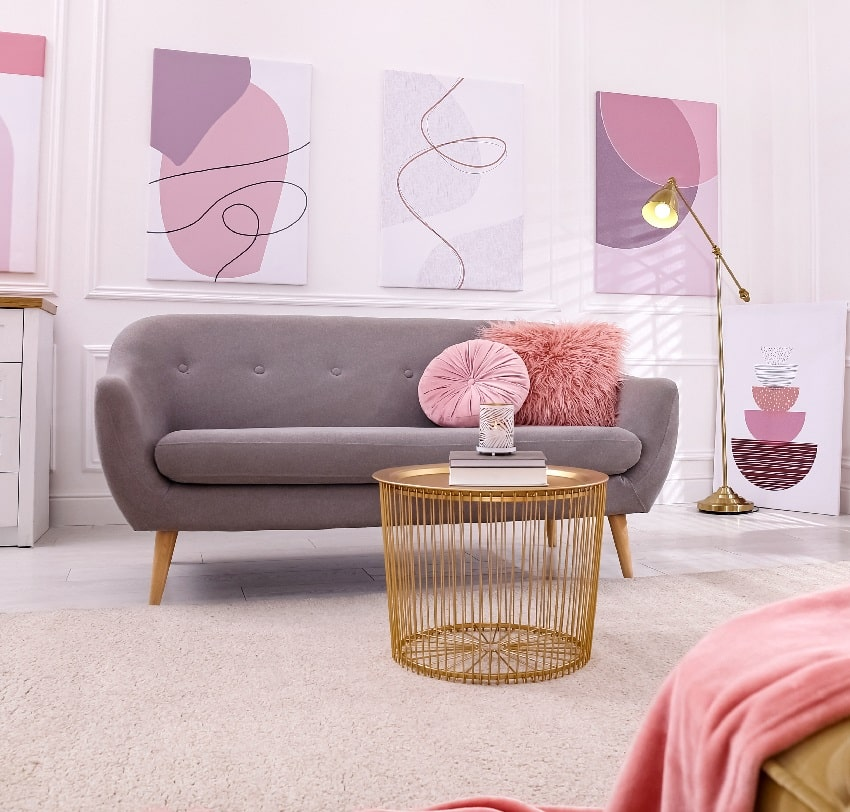 stylish taupe living room interior with comfortable sofa and wall frames