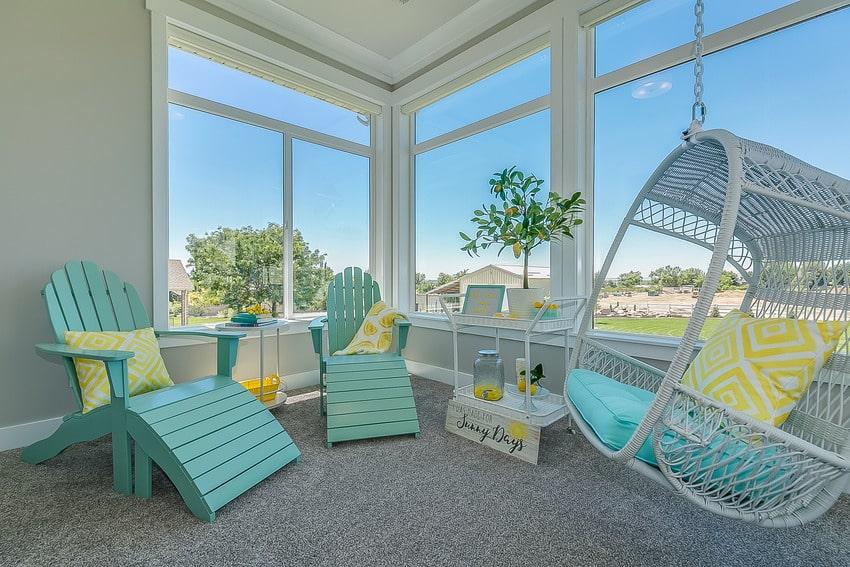 Sunroom with carpet flooring