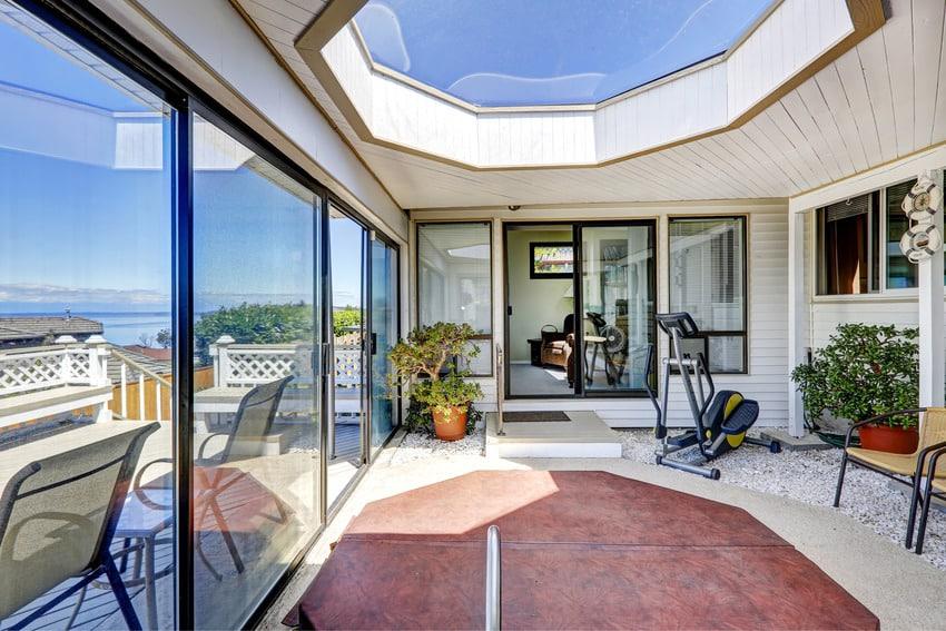 Sunroom with concrete floor