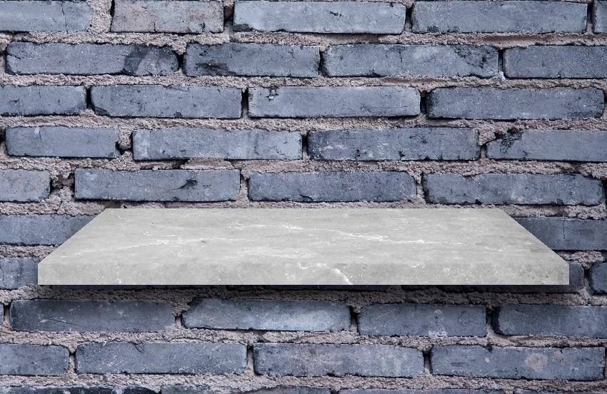 top shelf slab granite with brick wall