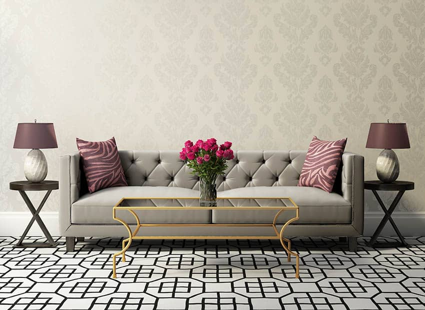 Traditional living room with patterned wallpaper grey velvet couch