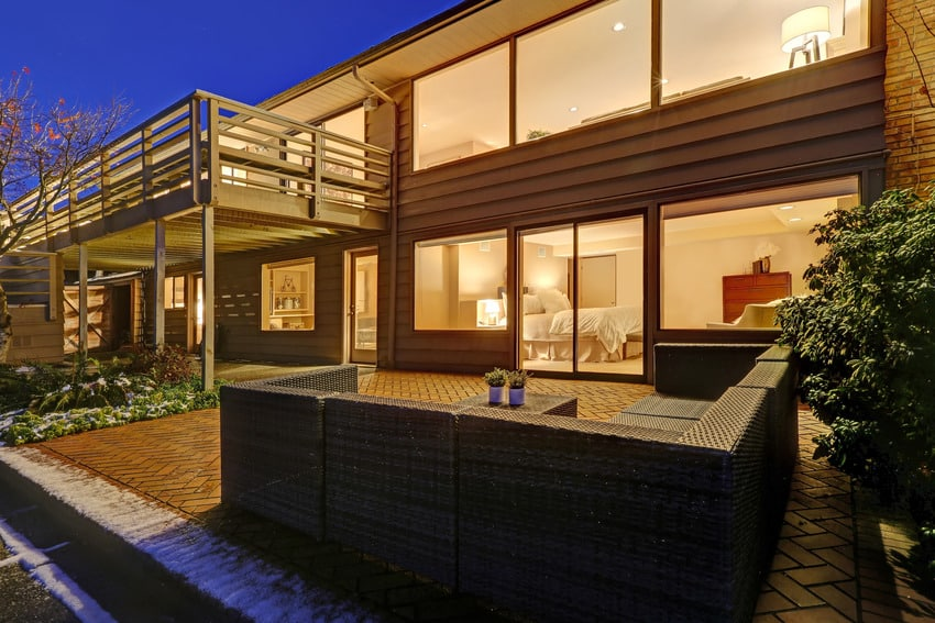 Two story home with douglas fir siding exterior plus an upper deck and lower poolside patio