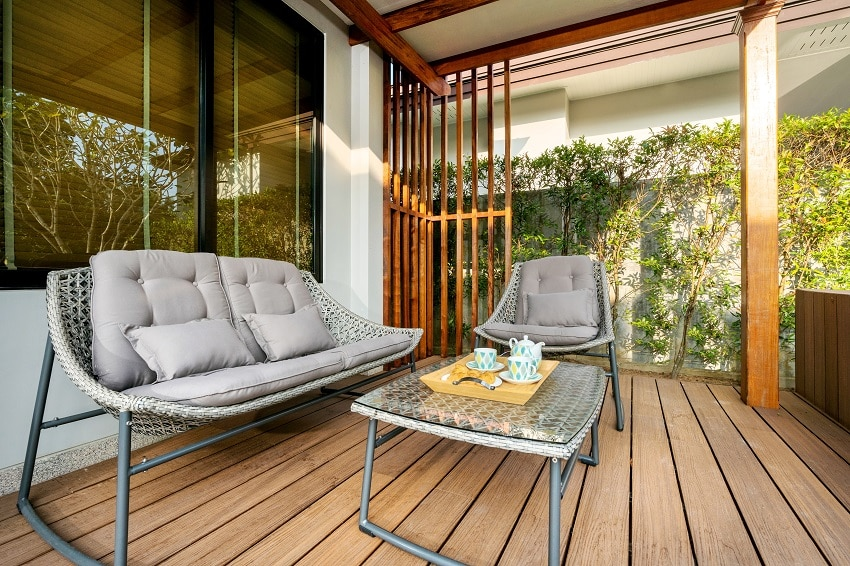 veranda with wooden composite decking and furniture