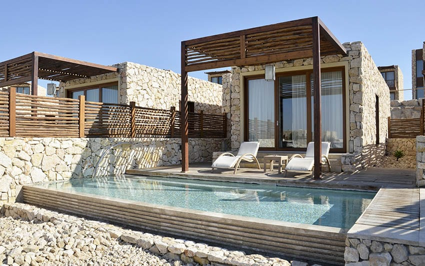Villa plunge pool with rustic wood pergola lounge chairs