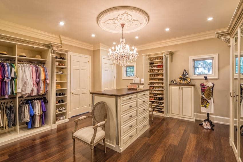 Walk-in closet center island chandelier wooden floor
