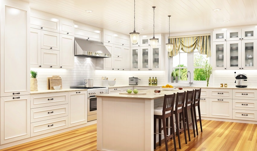 off white kitchen with cabinets wooden flooring white granite countertop island and brown chairs