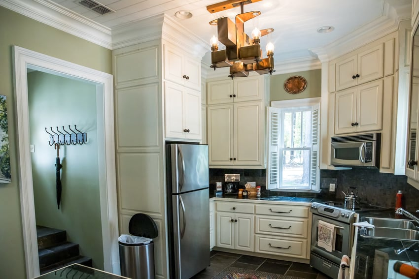 Wide view of kitchen with corner stove