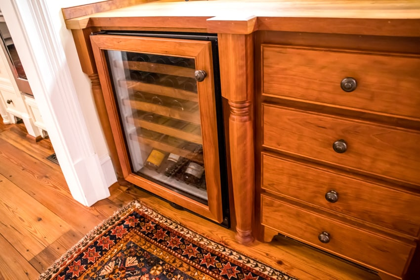 Wine bottle refrigerator with kitchen drawers