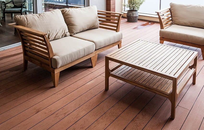 Wood outdoor furniture with cushions on deck