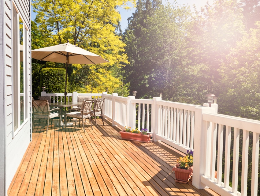 Wooden deck with white fences table and chairs