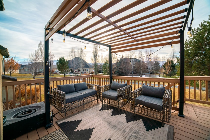 Wooden pergola on patio with string lights and outdoor furniture