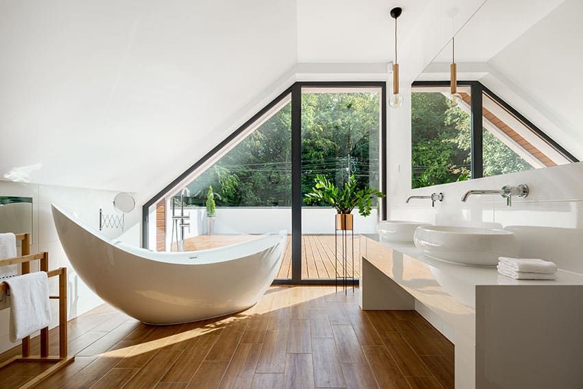 Bathroom attic roof with freestanding tub lavatory retro pendant lights