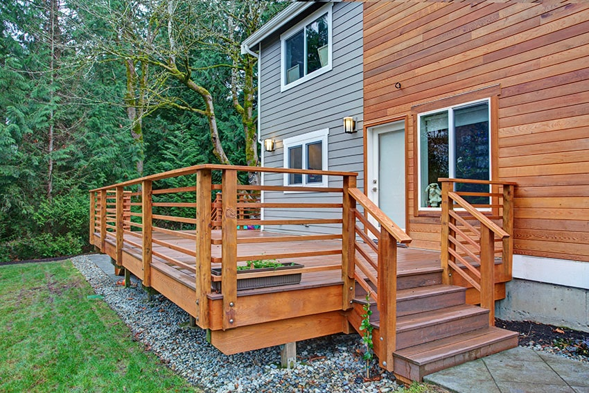 Deck with wooden house siding glass sliding window is
