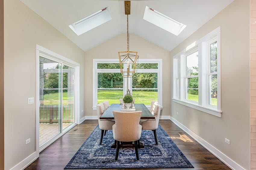 Dining room with blue rub french door velux window beige paint is