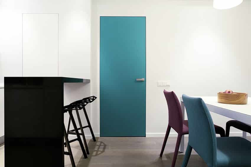 Hinged teal soundproof door with white wall counter table with stool ss