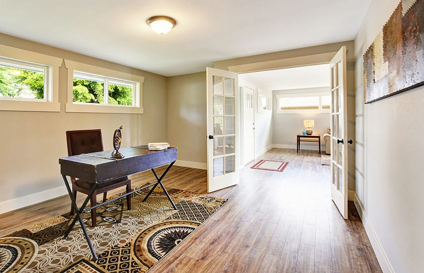 Home office room with french doors beige paint rug is