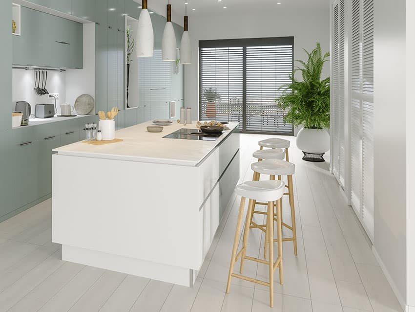 Kitchen with white counter and stools black blinds white pendant lights teal cabinets green plant