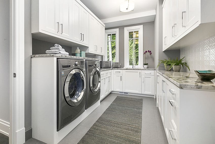 Laundry area with white cabinet gray paint is