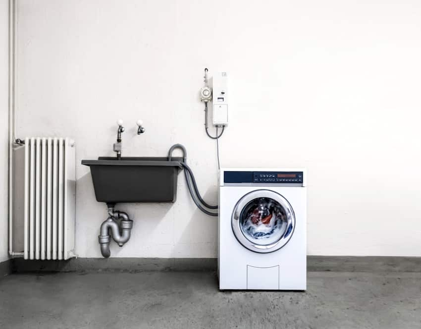 laundry room in garage with washing machine