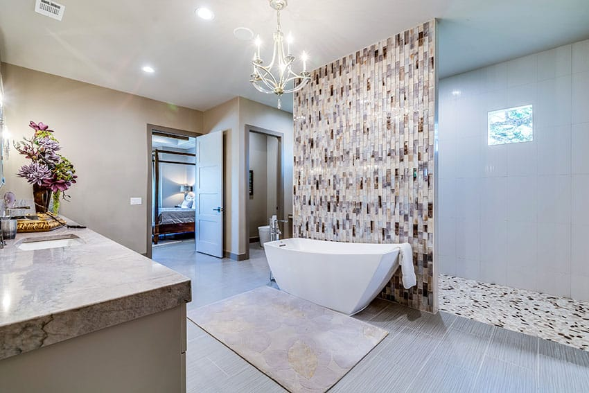 Master bathroom with freestanding tub beige wall paint