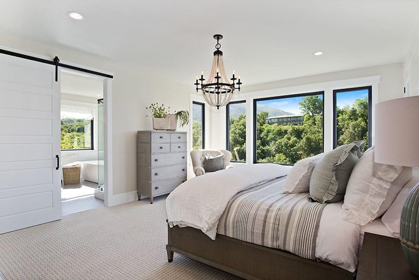 Master bedroom with bathroom glass window barndoor chandelier