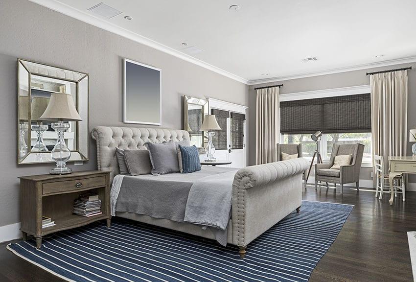 Master bedroom with king size bed black blinds