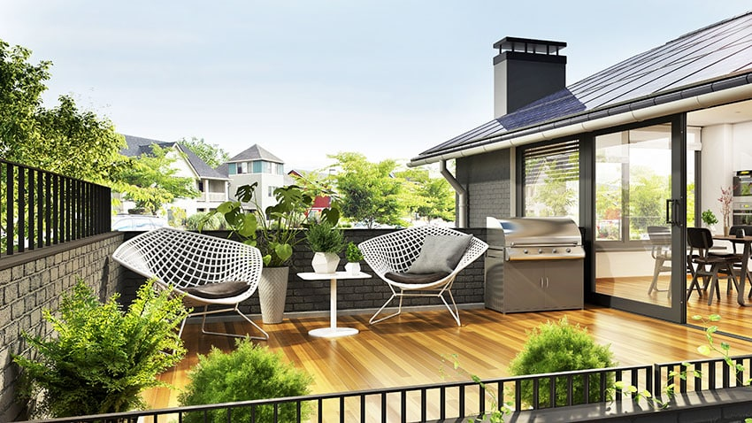 Patio with wicker chairs stainless griller glas door is