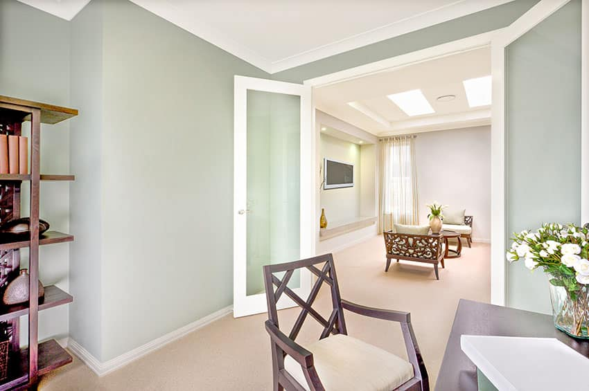 Room with glass doors light green paint is