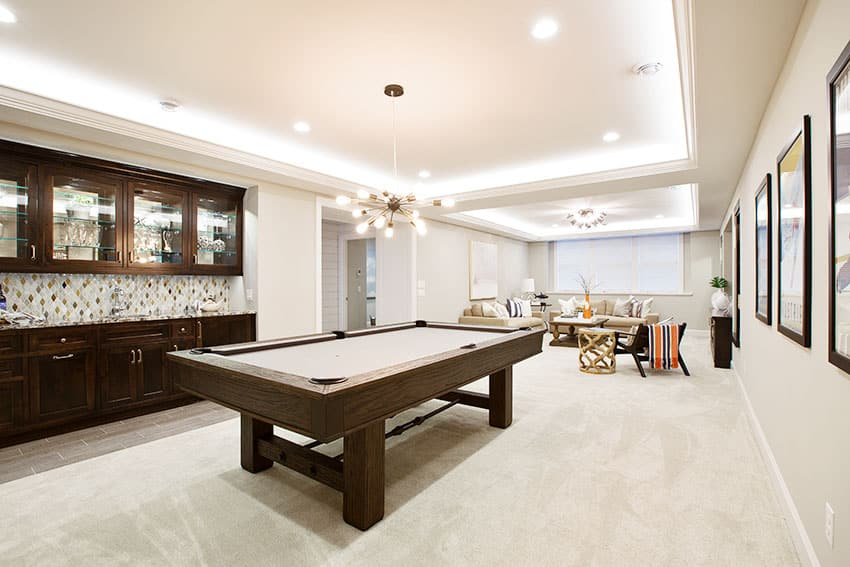 Basement game room with pool table and tray ceiling modern chandelier light paint