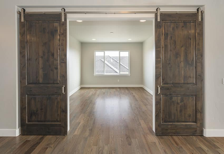 Room with sliding barn doors talo green paint is