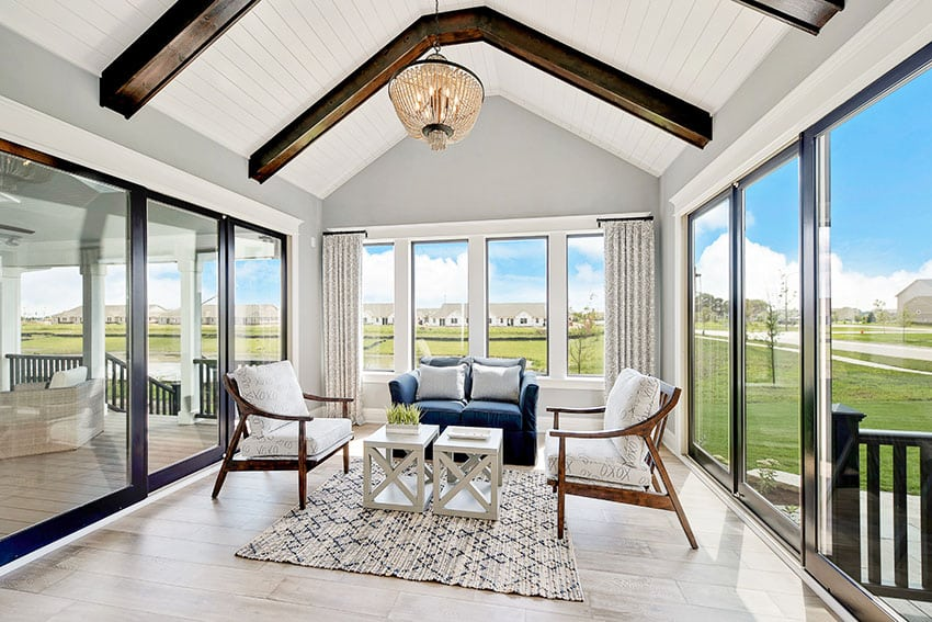 Sunroom with sliding glass doors cathedral ceiling chandelier is