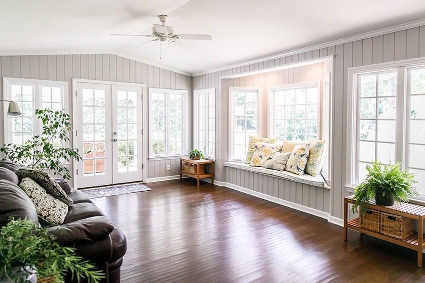 Sunroom with wooden floor french door bay window is