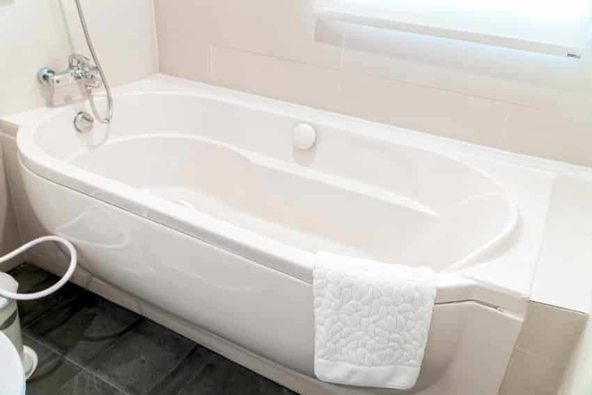 a detail of bathtub in a luxury bathroom