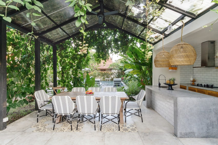 Aluminum covered patio with table chairs and outdoor kitchen