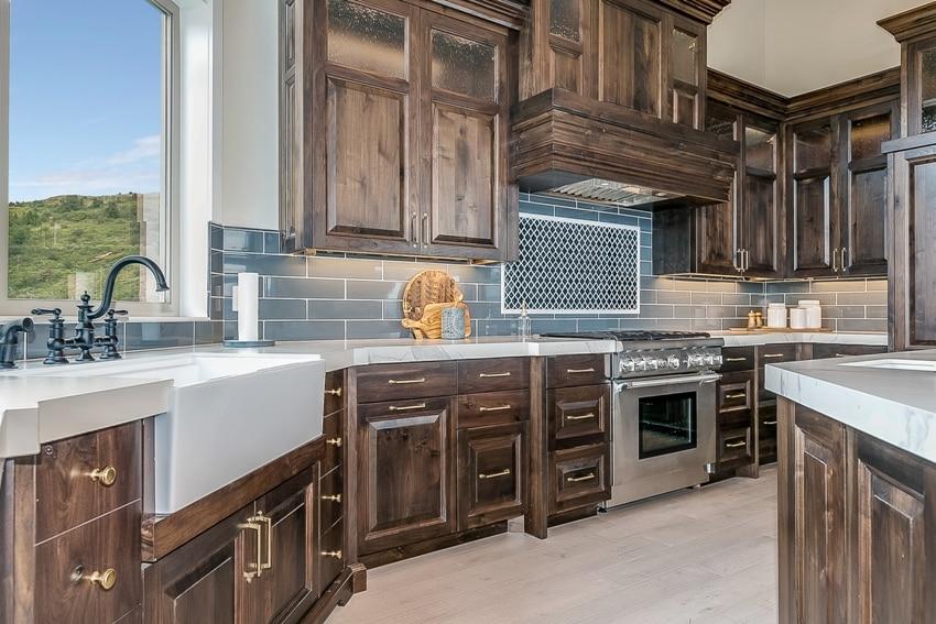 Amazing custom kitchen with farmhouse sink and elegant wood cabinets