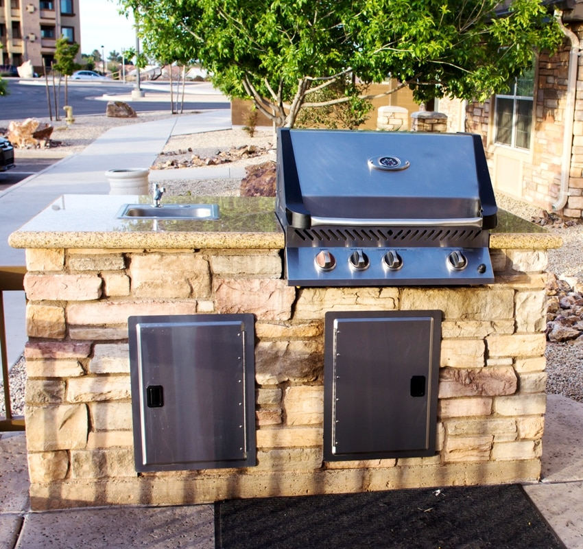 Barbeque grill with utility drawers