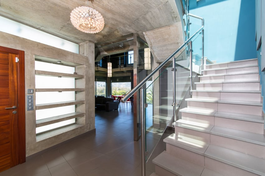 Basement with concrete wall and staircase