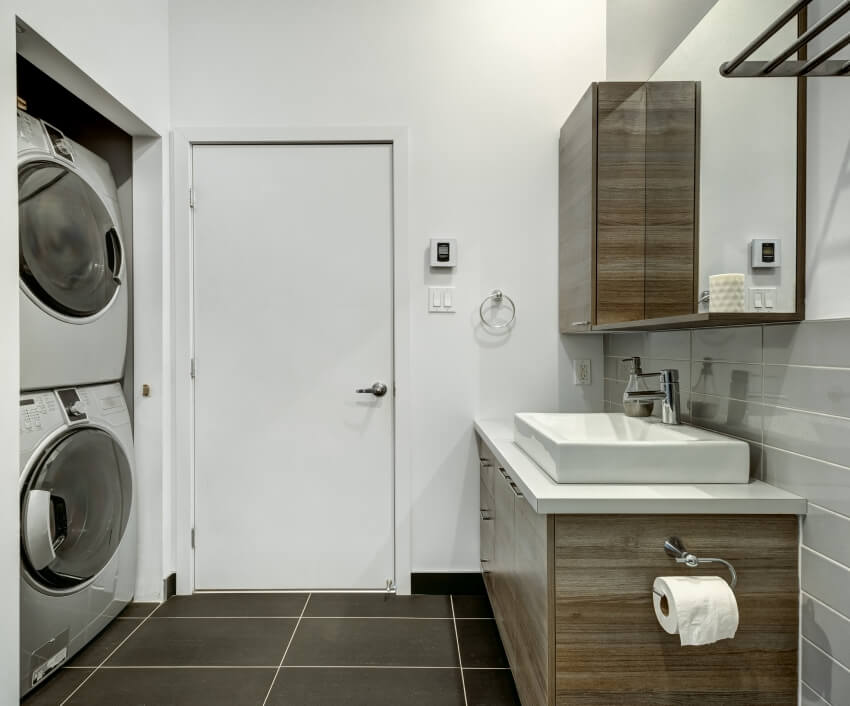 Bathroom with basin wood cabinet mirror washer and dryer